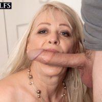 Elder ash-blonde lady Heidi fellates her stepson's hefty penis while seducing him