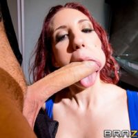 Red-haired MILF pornstar Kelly Divine takes it up the backdoor from a humungous cock in black nylons
