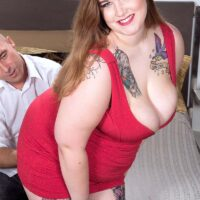 Tatted big sexy lady Emma uncovering her massive breasts and booty before providing a handjob