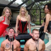 3 Dommes in fetish outfits manhandle 2 collared submissives on a poolside patio