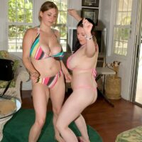 Dark-haired MILF Angela White strutting naked indoors and outdoors along with her girlfriends