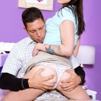 Youthful dark-haired female Dakota Blaze has her bloomers pulled over her butt before receiving cunnilingus