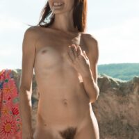 Bony amateur Scarlett Nika slipping off skivvies outdoors for hairy cooch spreading