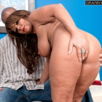 Marvelous granny Cassidy has her massive tits fondled while an ebony boy undresses her