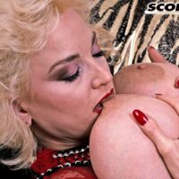 Huge titted platinum-blonde Chessie Moore plays with her hard nipples before slipping her panties to one side