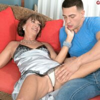 Sexy granny Sydni Lane is relieved of silver lingerie by her younger Latino lover