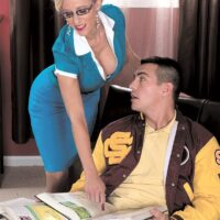 Hot older blonde Holly Claus gives a younger man a handjob while wearing a tight dress