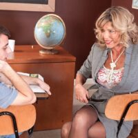 Hot older blonde teacher Shannon West seduces a much younger boy while in a classroom