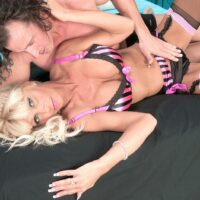 Hot over 60 blonde Stormy Lynne indulges in foreplay while in a bra and panty ensemble