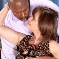 Classy grandmother Elle Denay as her natural tits exposed by her interracial lover