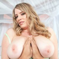 Busty blonde MILF Maggie Green takes a large cock in her hand during a POV scene