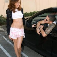 College girl Niki Fair gives a boy a ball sucking blowjob after accepting a ride home