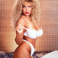Legendary XXX actress Taylor Marie releases her immense titties in a sundress and lingerie