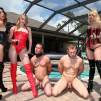 3 Dommes in fetish apparel abuse two man slaves out on the poolside patio