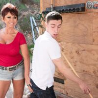 Over sixty dame Gina Milanos seduces a young dude with her massive titties in denim cut-offs