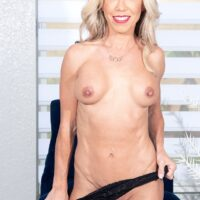 Beautiful mature blonde Mandy Monroe strips to her heels during her first nude shoot