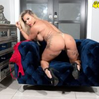 Busty older blonde Robbin Banx showcases her pussy after removing a bra and thong set