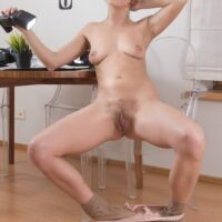 Platinum-blonde first-timer Ayda rolling hosiery down her legs while unsheathing her unshaven cooter