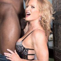 Elder platinum-blonde Amanda Verhooks welcomes her younger black paramour in marvelous lingerie