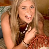 Young blonde Monika Dupree sticks her tongue out for jizz after sex with a large cock