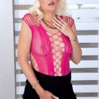 Older platinum blonde Marvellee toys her wet pussy and filthy asshole at the same time