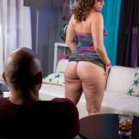 Overweight brown-haired chick flashing immense upskirt ass in thong undies and high heeled shoes