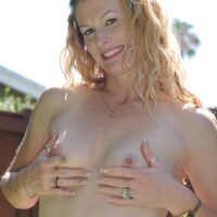 Aged amateur gal peels off a bathing suit to pose naked in a back yard