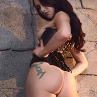 MILF adult film starlet Mandy Muse takes a backside boinking in ebony fishnet tights