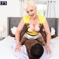 light-haired granny Seka Black fellates a junior man's enormous ebony cock