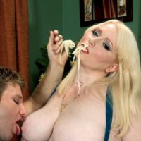 Big blonde pornostar Dawn Davenport tugging on a dick while devouring food and masturbating