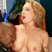 Seductive grannie Luna Azul seduces a younger black guy in satin lingerie and denim jeans on a bed
