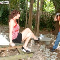Over 40 redhead Desi Foxx seduces a younger man during upskirt action while gardening