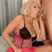 Uber-sexy golden-haired grandmother with amazing legs Natasha entices a blows a younger ebony boy