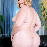 BBW model Marcy Diamond lets her massive bootie free from denim cut-offs to pose naked